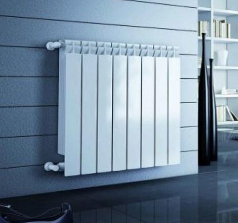 Алюминиевые радиаторы на стене
