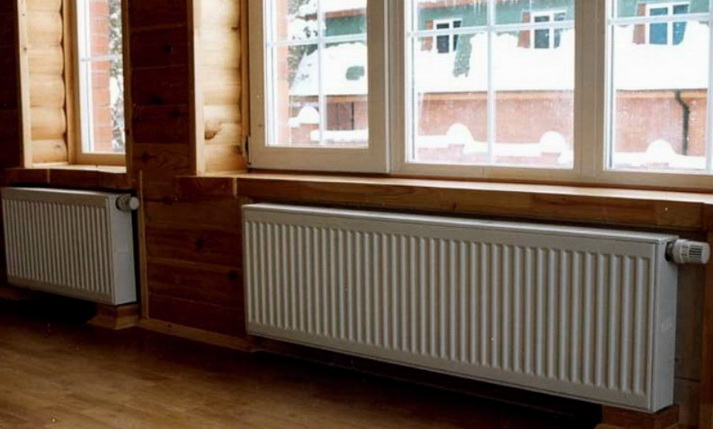 Стальные радиаторы на стенах